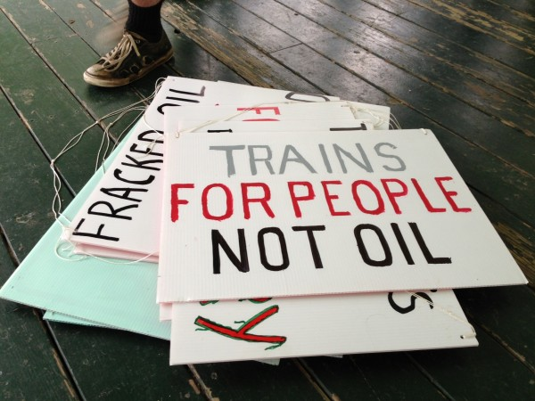 Signs made by a group planning to protest against the railroad carrying crude oil through Maine to New Brunswick Thursday evening. The group known as 350 Maine planned to blockade tracks in Fairfield to prevent a train from passing through.