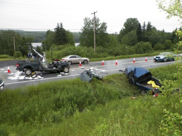 Two men were hospitalized after a two-vehicle crash on Route 11 on Thursday morning.