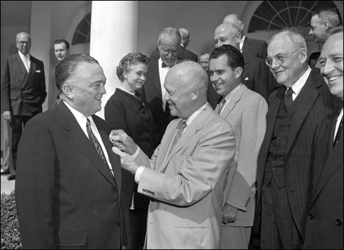 Director Hoover receives the National Security Medal from President Dwight Eisenhower on May 27, 1955, as then-Vice President Richard Nixon and others look on.