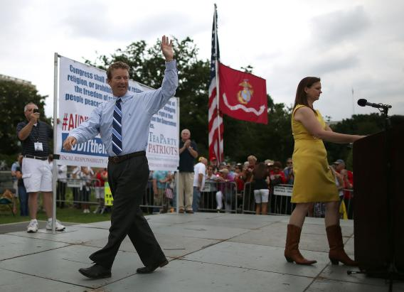 Sen. Rand Paul, R-Ky., waves to the crowd during a Tea Party rally in front of the U.S. Capitol on June 17, 2013.