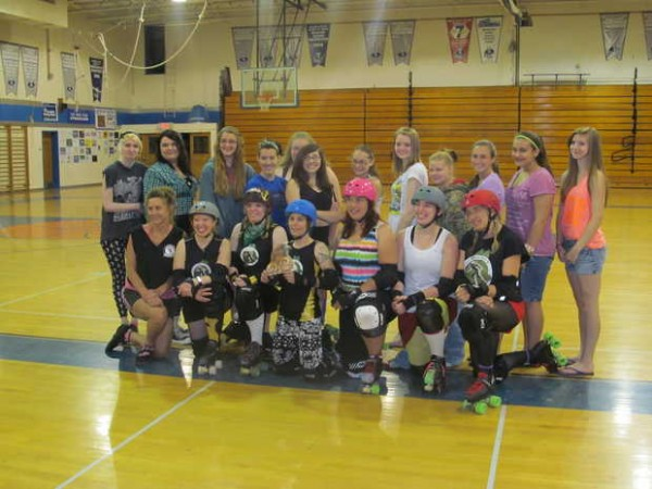 The Central Maine Derby team from Bangor poses with a group of incoming Mountain Valley High School students Wednesday morning inside Puiia Auditorium. The Central Maine Derby team visited to present their &quotSkate Not Hate&quot program, where they teach students about roller derby and about preventing school bullying.