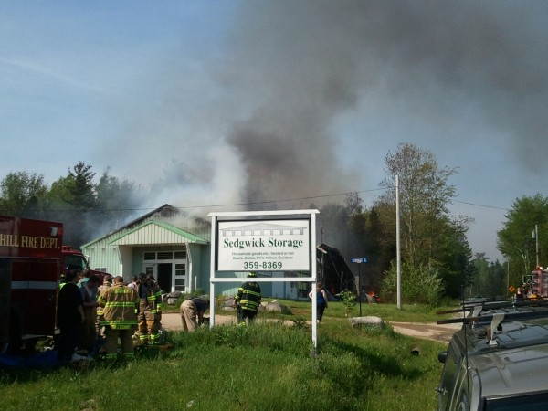 Crews battle a fire at Sedgwick Storage in Sedgwick on Saturday.