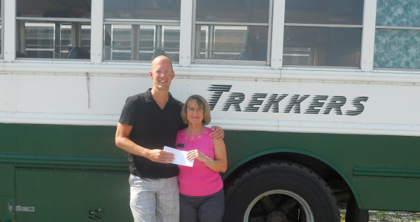 Trekkers' Executive Director Don Carpenter receives a donation from  Camden National Bank Branch Manager Connie Sawyer.