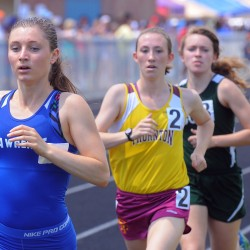 Erzsebet Nagy (left) of Lawrence High School won the girls 1600 meter run with the time of 5 minutes, 01.07 seconds during the Class A State Championship Track and Field meet Saturday at the Brewer Community School.