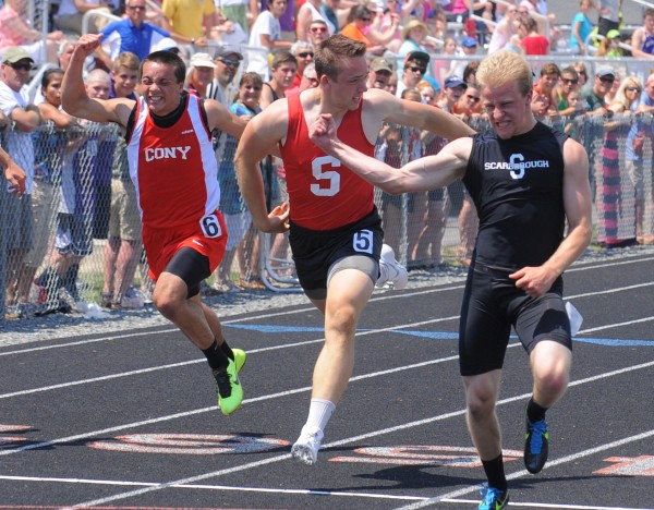 Ryan Jamison of Scarborough (right) celebrates after winning the boys 100-meter dash during the Class A State Championship Track and Field meet Saturday at the Brewer Community School.  Jamison's time was 11.18 seconds.  Also pictured from left Luke Dang of Cony High School and Alex Shain of Sanford.