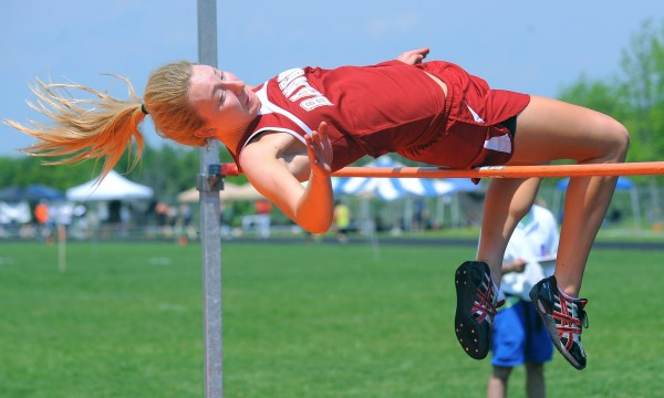 Bangor's Grace MacLean clears the 5-foot, 4-inch height during the Class A State Championship Track and Field meet at the Brewer Community School Saturday.  MacLean finished second in the competition.