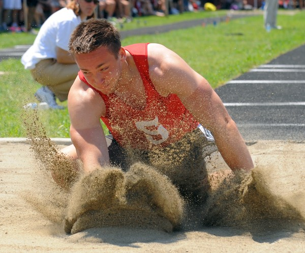 Alex Shain of Sanford lands in the sand on one of his attempts in long jump during the Class A State Championship Track and Field meet at the Brewer Community School Saturday.  Shain finished second with the distance of 21 feet.