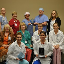 Calais Regional Hospital was recognized with four awards for patient satisfaction, including Overall Best Performer for 2012.   Above CRH staff from many areas of the hospital display the awards presented for their service excellence.