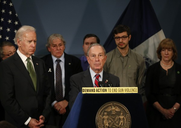 New York City Mayor Michael Bloomberg is joined by Vice President Joseph Biden (left) and family members of victims of Sandy Hook school shooting during a news conference at City Hall in New York, on Thursday, March 21, 2013.