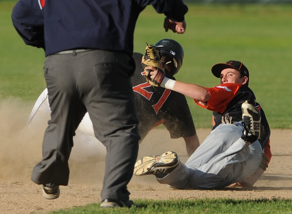 Brewer's Logan Rogerson looks to the umpire after tagging Brunswick runner Charlie Lowell at second base during 2nd inning action at Brewer on Tuesday. Lowell was called out.