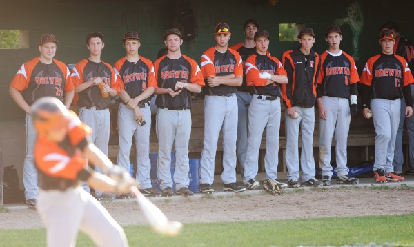 Members of the Brewer High School baseball team watch a teammate bat during an Eastern Maine Class A prelim against Brunswick Tuesday in Brewer. Brewer defeated Brunswick 1-0 in nine innings.