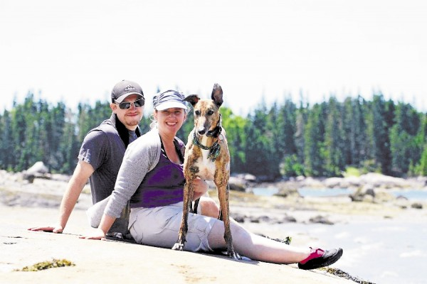 Our happy little family in 2012 on an outing to the beach. We adopted Laura in 2008 from Maine Greyhound Placement Service. Our cat Olivia chose to stay home while we went to the beach.