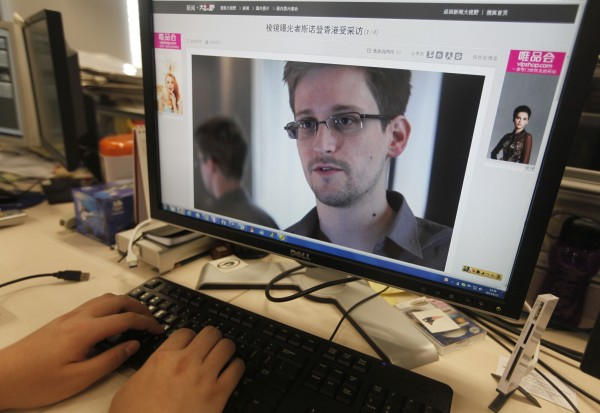 A picture of Edward Snowden, a contractor at the National Security Agency (NSA), is seen on a computer screen displaying a page of a Chinese news website, in Beijing in this June 13, 2013 photo illustration. China's Foreign Ministry offered no details on Thursday on Snowden, the NSA contractor who revealed the U.S. government's top-secret monitoring of phone and Internet data and who is in hiding in Hong Kong. The Chinese characters of the title read: &quotPRISM program whistleblower Snowden being interviewed in Hong Kong&quot.