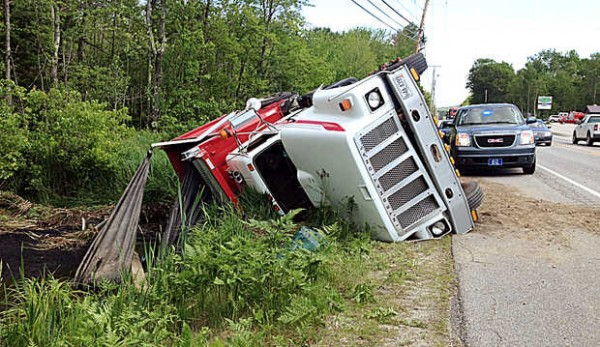 After a collision with another vehicle, a truck rolled over on Route 4 in Turner.