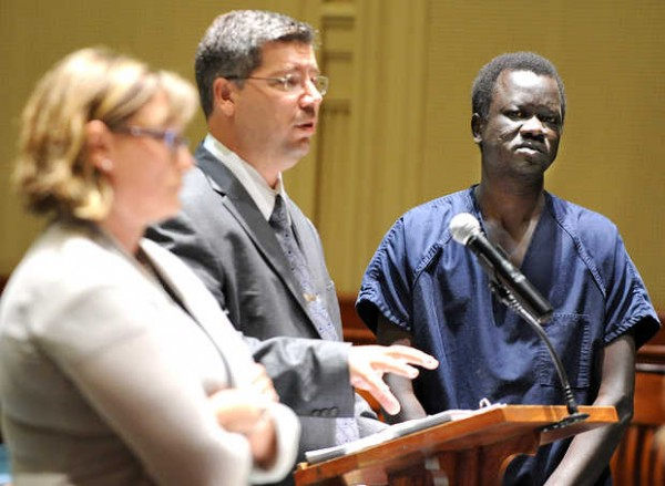 Deng Mirac, right, looks on as his lawyer, Nicholas Worden, center, addresses Justice MaryGay Kennedy in Androscoggin County Superior Court in Auburn on Thursday afternoon during Mirac's bail hearing. At left is Assistant District Attorney Lisa Bogue.