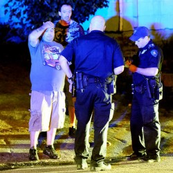 Lewiston police officers talk with witnesses about the brawl on Bartlett Street in downtown Lewiston on Thursday.