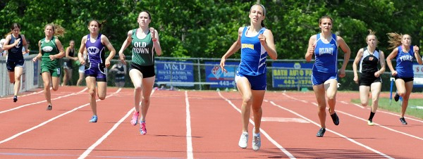 Hermon's Kaitlin Saulter, center, pulls away from the field in the final stretch of the 400 meter during Saturday's Class B championship meet at Morse High School in Bath.  To her left, finishing second, is Old Town's Kelsey Maxim.