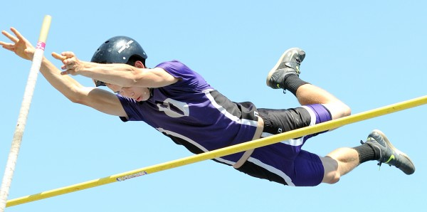 Waterville's Devin Burgess clears the bar at 13 feet, 6 inches to move to the next height during Saturday's Class B championship meet at Morse High School in Bath.