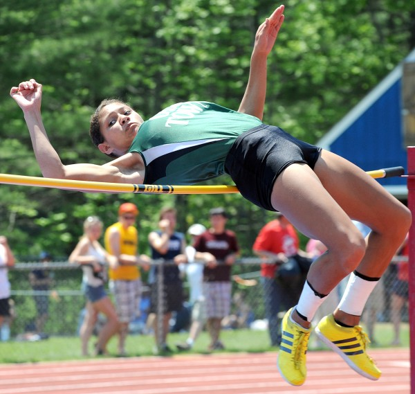 After winning the high jump and leaving the field behind, Old Town's Tia Jackson just misses clearing the bar during this attempt at 5 feet, 4 inches during Saturday's Class B championship meet at Morse High School in Bath.
