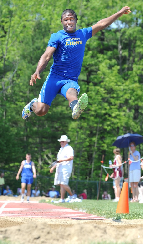 Marcus Riley of Belfast flies through the air during the long jump competition during Saturday's Class B state championship meet at Morse High School in Bath.