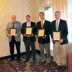 Jim Ring, project representative for Cross Insurance Center, Jon DiCentes of Cianbro Corp., and Rob Frank and Ray Bolduc of WBRC Architects ∙ Engineers receive the Maine Chapter of Construction Specifications Institute (CSI) Award of Excellence on June 4, 2013 in Auburn, Maine. Photo: Maine Chapter of Construction Specifications Institute