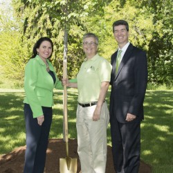 Christina Parrish of Brewer, ME (center), a five-year cancer survivor celebrates life on June 7, 2013 at the Celebrate Life Tree planting ceremony with Scott Jones, President and CEO (right), and Annie Stephenson, Chairman Elect at Cancer Treatment Centers of America (left), pictured at Cancer Treatment Centers of America at Midwestern Regional Medical Center.  A tree will be planted in Mildred Copelands' honor. This year, nearly 300 trees will be planted in honor of all five-year cancer survivor celebrants.