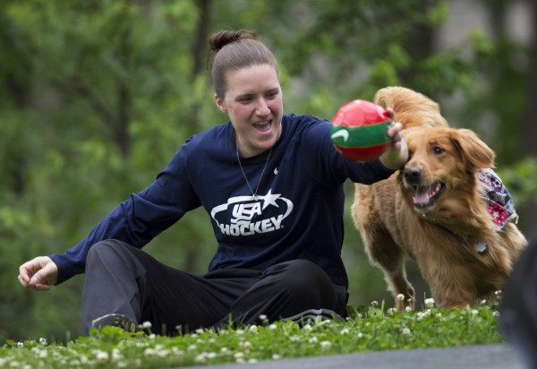 Christy Gardner plays with her service dog, Moxie, Thursday, June 13, 2013, in Lewiston, Maine.