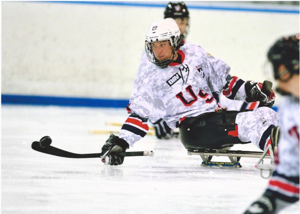 Christy Gardner competes for the USA Warriors in a sled hockey game. Gardner is an Army veteran who was just named USA Hockey's Disabled Athlete of the Year.