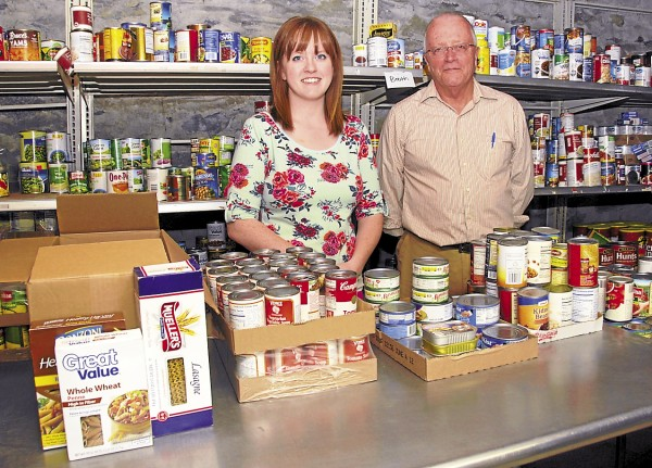 Standing in the food pantry at the Bangor Area Homeless Shelter are Courtney O'Donnell, administrative assistant and volunteer coordinator, and Executive Director Dennis Marble. The shelter is located at 263 Main St., Bangor.