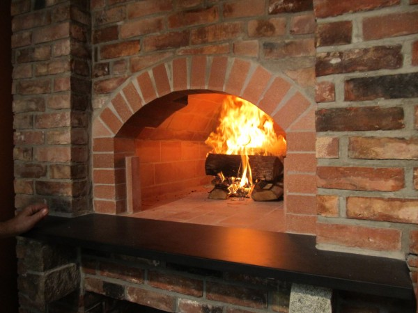 Custom wood fired oven in Fossa's certified commercial kitchen