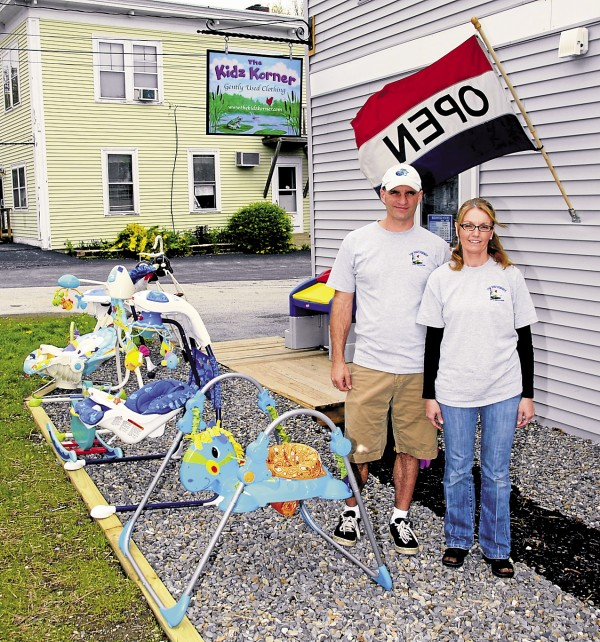 Greg and April DaSilva display some of the children's toys and other items that they carry at Kidz Korner, located on the Main Road South (Route 1A) in Hampden. The DaSilvas opened the store on May 1, 2013. 