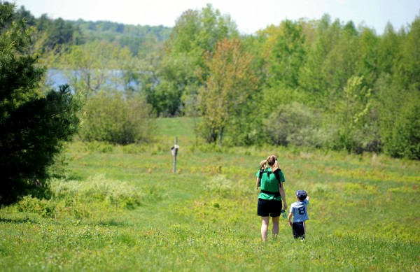 April McKinney of Levant enjoys a day of walking the trails at Fields Pond Audubon Center with her sons Zen Taylor, 4, and Finn McKinney, 2 months.