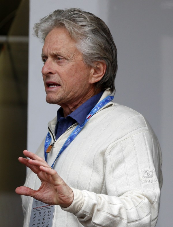 Actor Michael Douglas gestures at the Ferrari paddock before the qualifying session of the Monaco F1 Grand Prix May 25, 2013.