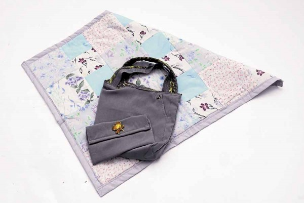 After her mother passed away, Marie Lander, owner of Mer's Fabrications in Eddington, created this handbag and coin purse from clothing her mother wore to Mass on Sundays. The quilt also is made from her mother's clothing.