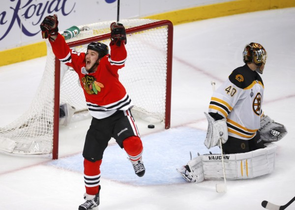 Chicago Blackhawks center Andrew Shaw (65) celebrates scoring in triple overtime on Boston Bruins goalie Tuukka Rask to win Game 1 of their NHL Stanley Cup Finals series in Chicago Wednesday night.