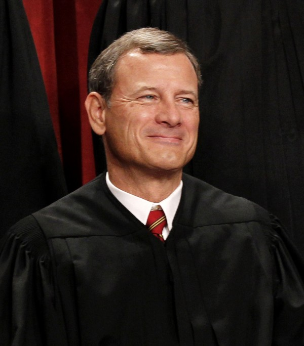 Oct. 8, 2010 file photo, Chief Justice John Roberts is seen during the group portrait at the Supreme Court Building in Washington.