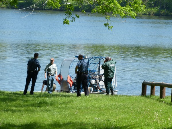 Brunswick police, fire and Maine State Marine Patrol personnel prepare to launch two boats to recover a reported floating body they later recovered near Brick Island in Bowdoinham.