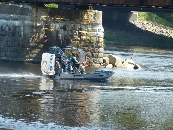 A Brunswick Police Department boat heads towards Merrymeeting Bay from the Water Street boat launch in Brunswick this morning following the report of a floating body found.