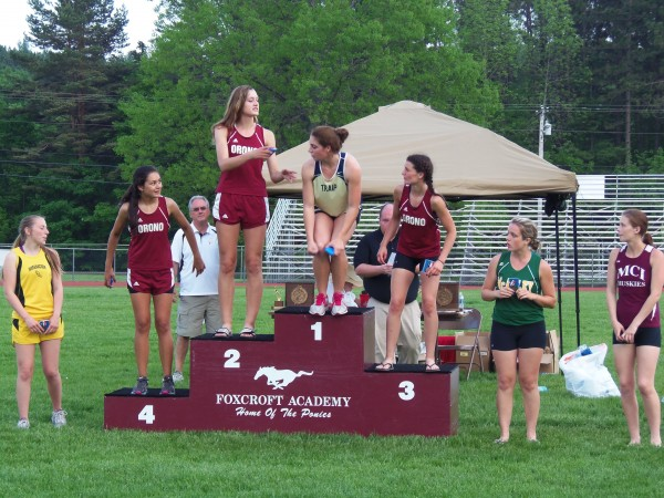 Competitors in the pole vault react after receiving their medals during the Class C state track and field meet at Foxcroft Academy Saturday. From left are: 6th place Jolene Potter, Maranacook J8-0, 4th place Allison Pickering, Orono 8-6, 2nd place Abby Weigang, Orono 9-0, 1st place Kelsey Barnes, Traip 10-6R, 3rd place Kayla Marquis, Orono J9-0, 5th place Elizabeth Houston, McAuley 8-0,and 7th place Katie Cronkite, MCI J8-0.