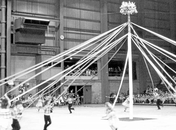 This double-twined Maypole dance, performed by dancers taught by Peg Bennett, was a feature of the May Festival dance recital Bennett organized each year for her nearly 1,000 dance students. The event filled the Bangor Auditorium with as many as 4,500 proud parents each year. Bennett taught square, contra and round dance in the Bangor area for more than 30 years. She died in 1983.