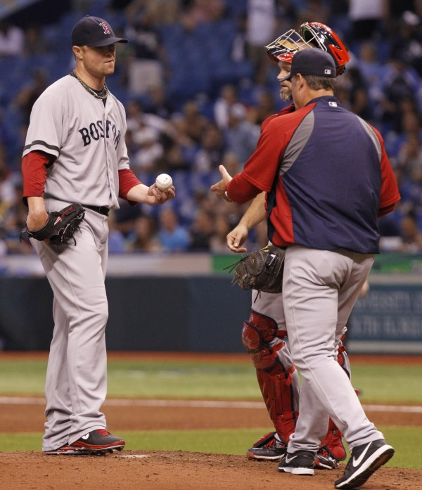 Boston Red Sox starting pitcher Jon Lester hands the ball over to manager John Farrell as he is taken out of the game during the fifth inning against the Tampa Bay Rays at Tropicana Field Tuesday night. Tampa Bay won 8-3.