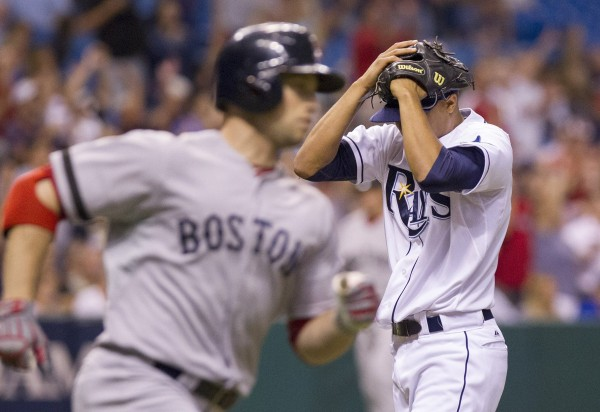 Tampa Bay Rays pitcher Chris Archer, right, buries his head in his hands after Daniel Nava, left, of the Boston Red Sox hit a two-run home run in the third inning on Wednesday night, June 12, 2013, at Tropicana Field in St. Petersburg, Fla.