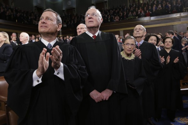 U.S. Supreme Court Chief Justice John Roberts applauds as Associate Justice Anthony Kennedy, Ruth Bader Ginsburg, Stephen Breyer, Sonia Sotomayor and Elena Kagan look prior to President Obama's State of the Union speech on Capitol Hill in in this Washington, February 12, 2013 file photo.