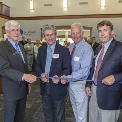 Peter Thompson, William Stokes, Roger Gifford and John Witherspoon cut the ribbon to Skowhegan Savings new Augusta branch.