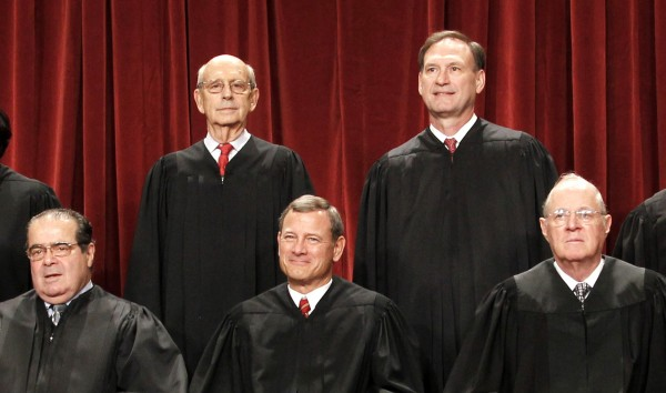 U.S. Supreme Court justices pose for a photo at the Supreme Court in Washington. Four Republican-appointed justices, front row from left, Antonin Scalia, Chief Justice John Roberts, Anthony M. Kennedy and top right, Samuel Alito Jr., at top left is Justice Stephen Breyer.