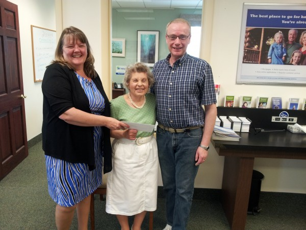 Sheryl Cox, Bangor Savings Bank Searsport Senior Customer Service Representative (left) was pleased to present a check for $1,000 to Searsport Historical Society's Doris Fahlberg (center) and David Oakes (right). Searsport Historical Society has been retaining and maintaining the memories and artifacts associated with the heritage of Searsport Maine. They were one of this year's $1,000 Community Matters More recipients.