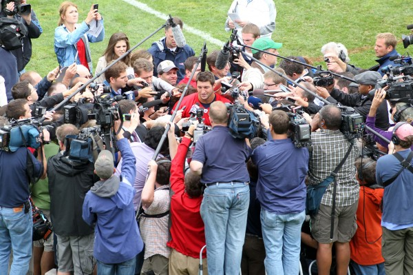 Members of the media surround New England Patriots quarterback Tim Tebow following minicamp at Gillette Stadium Tuesday.