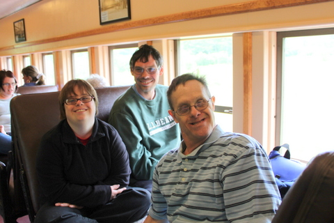 Program participants from left to right: Whitney Eaton, Christian Cooper and John Hayes are all smiles for riding on the train.