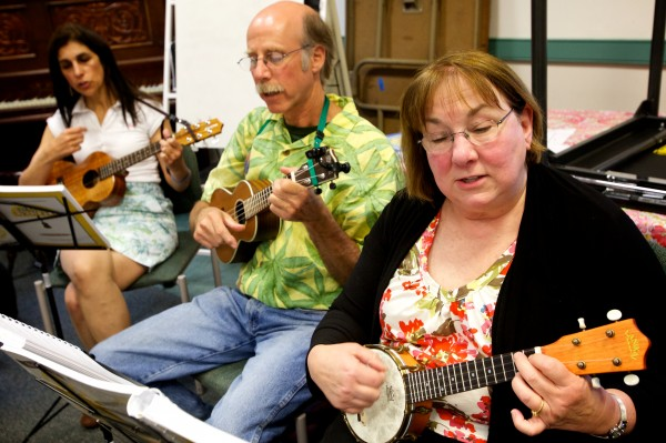 Leisa Barker (from left), Pays Payson and Carol Altman rehearse with the Falmouth Library Ukulele Ensemble, better known as the FLUKES, on a recent Wednesday night.