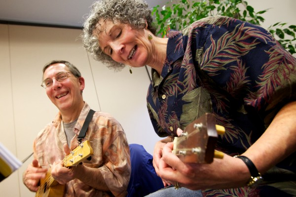 Rick and Lynne Gammon play along with the Falmouth Library Ukulele Ensemble, better known as the FLUKES, on a recent Wednesday night.